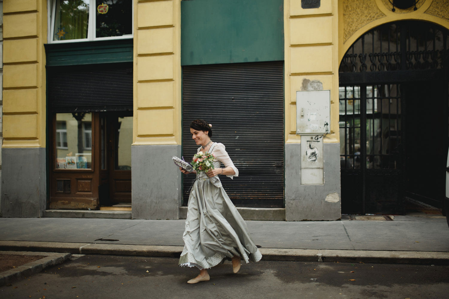 vienna bride running back home to get bouquet