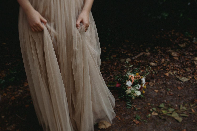 pale beige wedding dress and bouquet