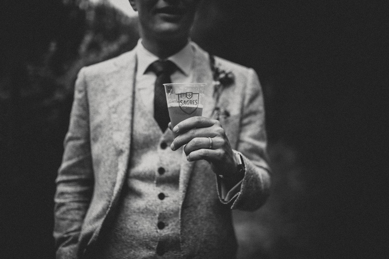 groom holding portuguese beer