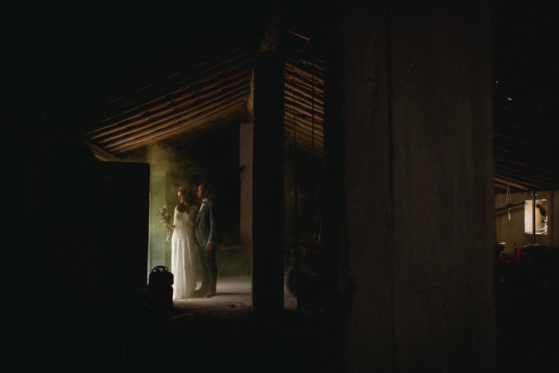 alternative couple portrait with yellow smoke barn in a boho barn wedding portugal
