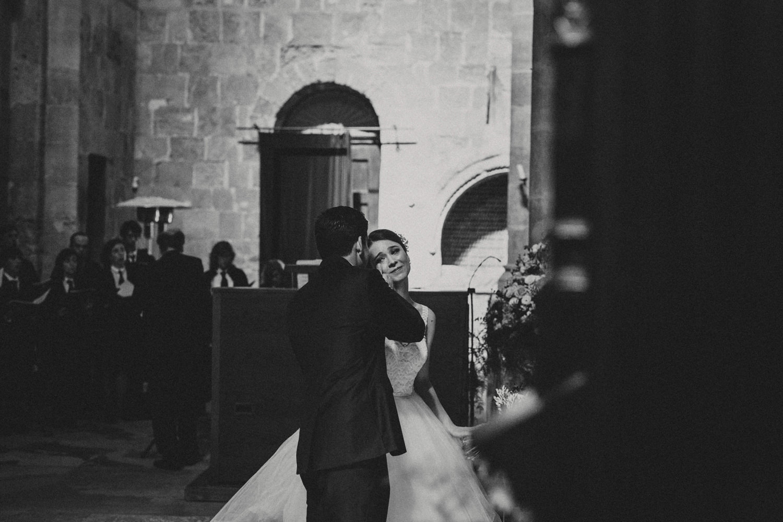 groom wiping brides tears on the wedding ceremony in sé velha coimbra