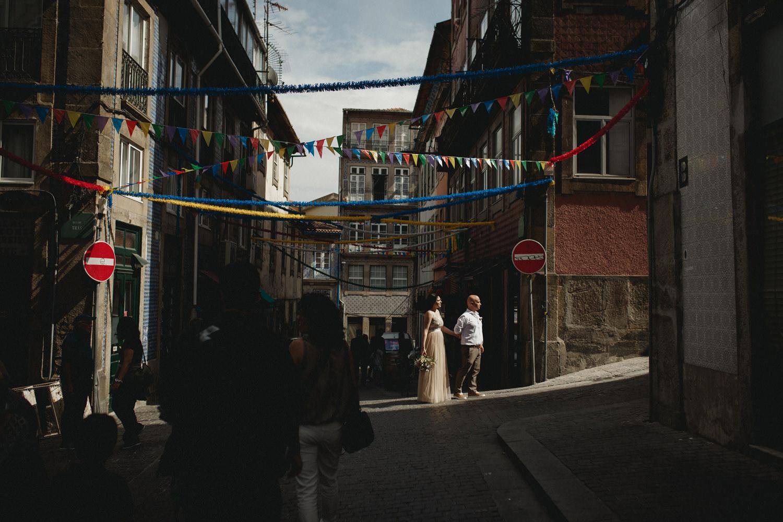 alternative bride and groom on the festive streets of porto portugal