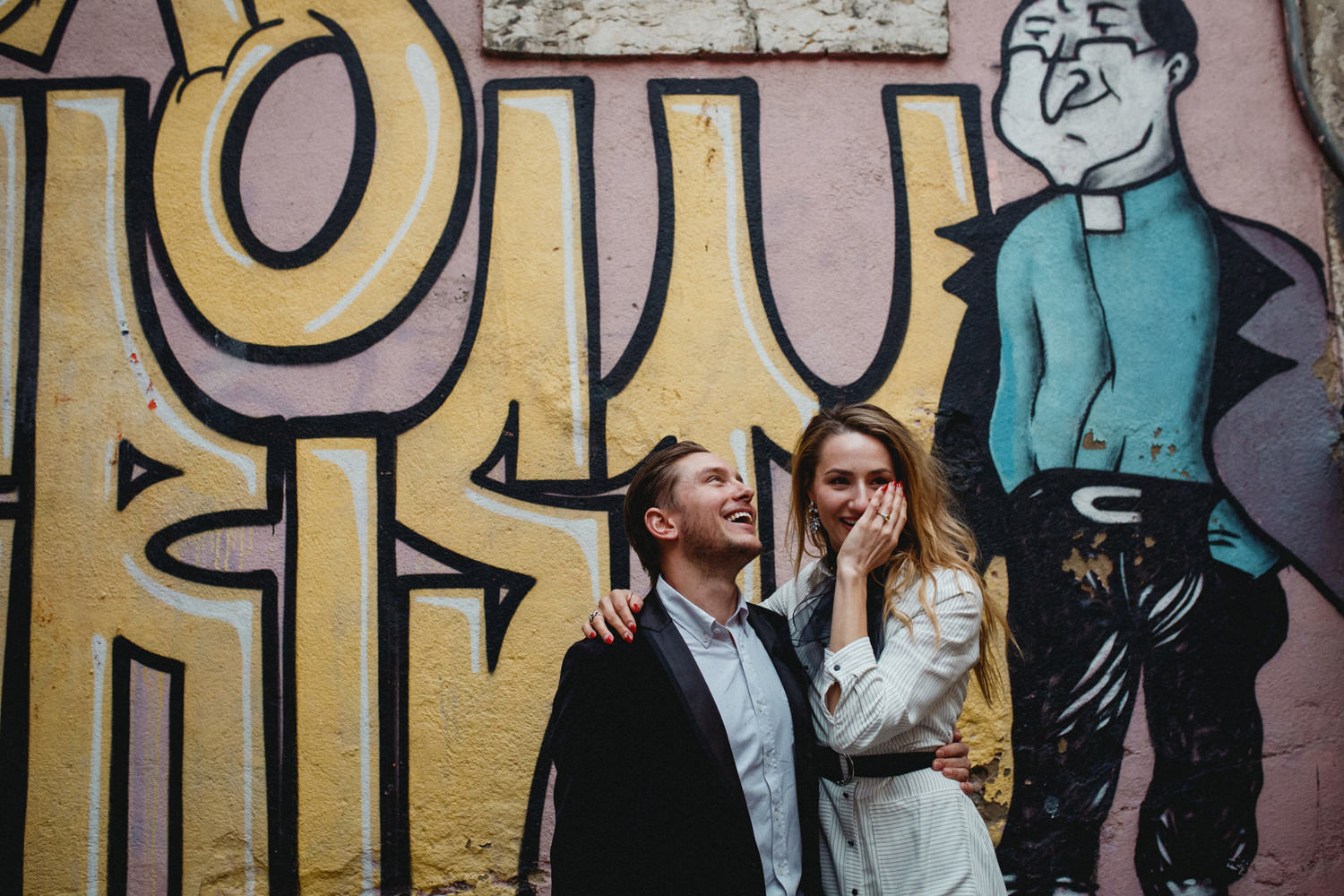 bride still emotional after getting engaged in lisbon portugal in front of a graffiti wall