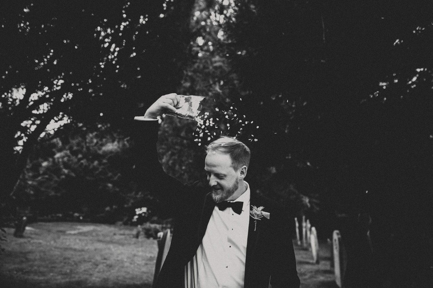 groom playing with confettis after alternative wedding uk