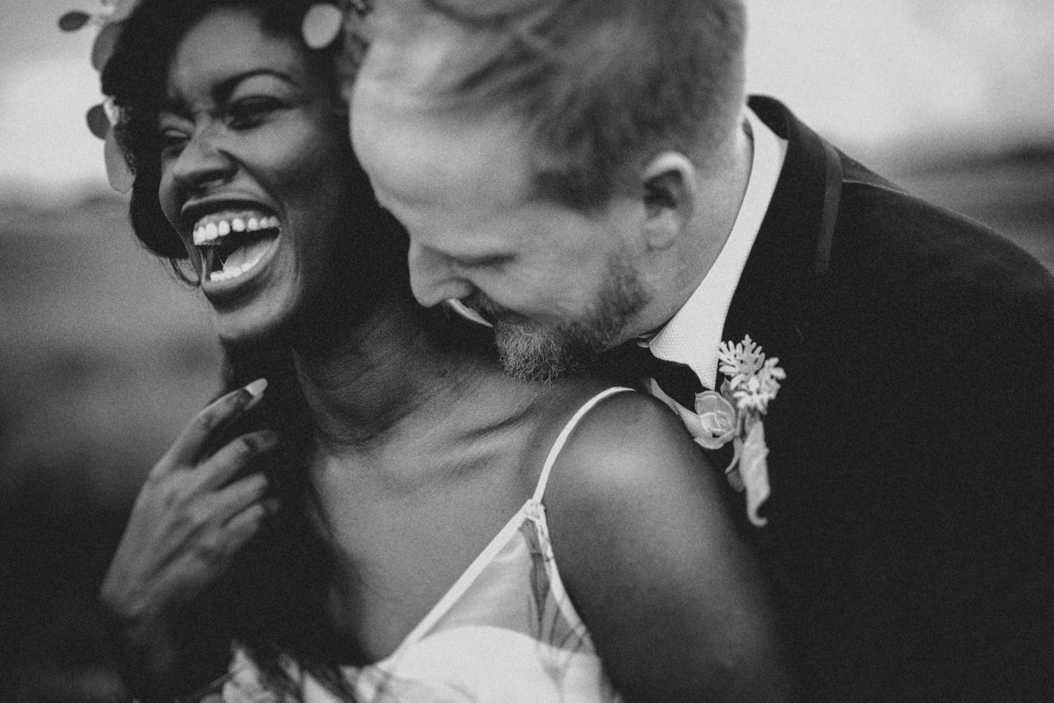 candid moments between alternative couple in a UK wedding
