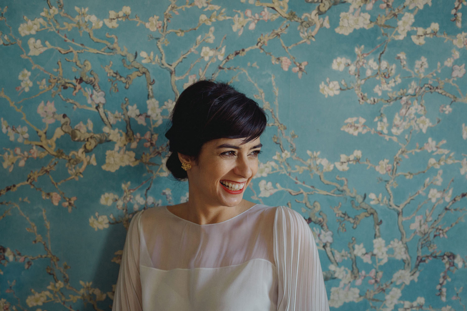 smiling bride in front of stylish vintage wall on lisbon wedding