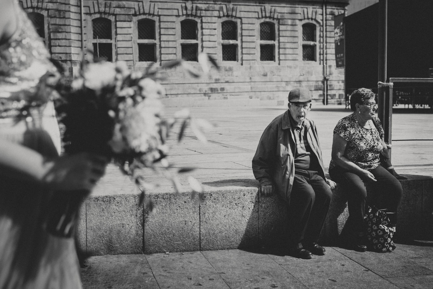 elderly man fascinated by gorgeous bride walkin on the streets of porto for her wedding