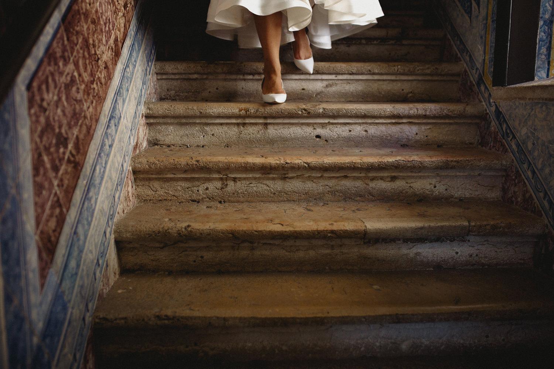 lisbon bride walking down the old tile staircase lisbon wedding photographers