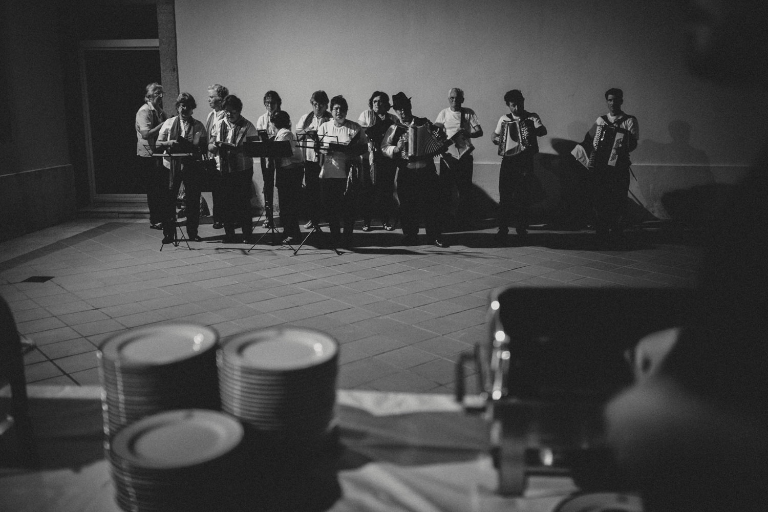 group of locals singing folk songs on a portugal wedding rehearsal dinner