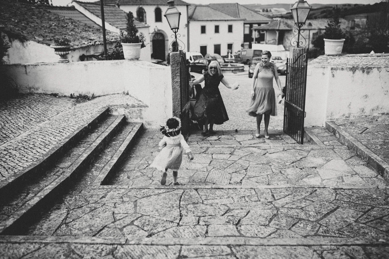 flower girl meets her grandma before a wedding ceremony in aldeia galega de merceana portugal