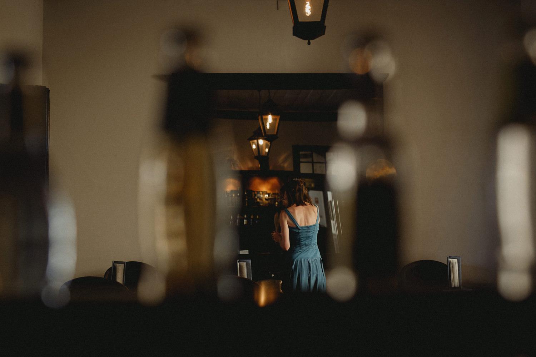 bridesmaid getting ready at a portuguese palace before a lisbon wedding
