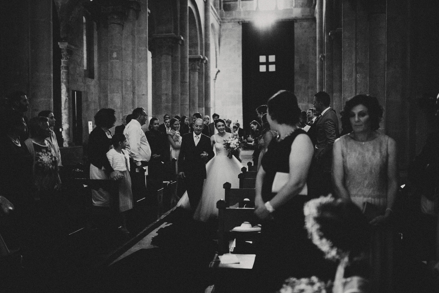 bride and her father walking down the aisle at se velha coimbra wedding