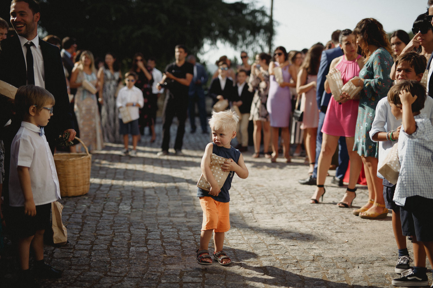 kids at a portugal wedding before tossing the petals