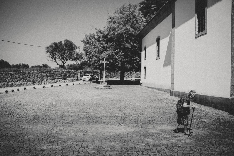 elderly lady entering the church in a portugal wedding