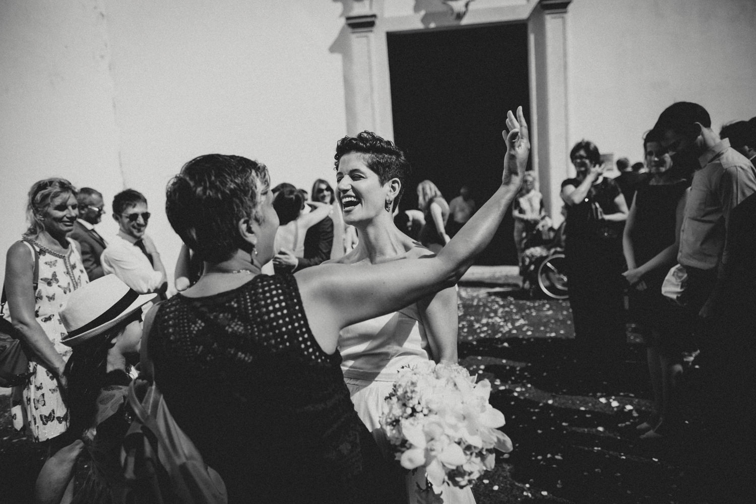 candid moments with short haired bride after a wedding in lisbon lisbon wedding photographers