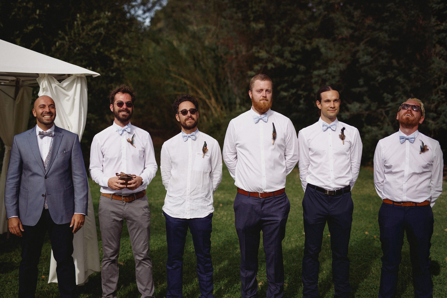 emotional groom and groomsmen while bride walks down the aisle in a portuguese wedding