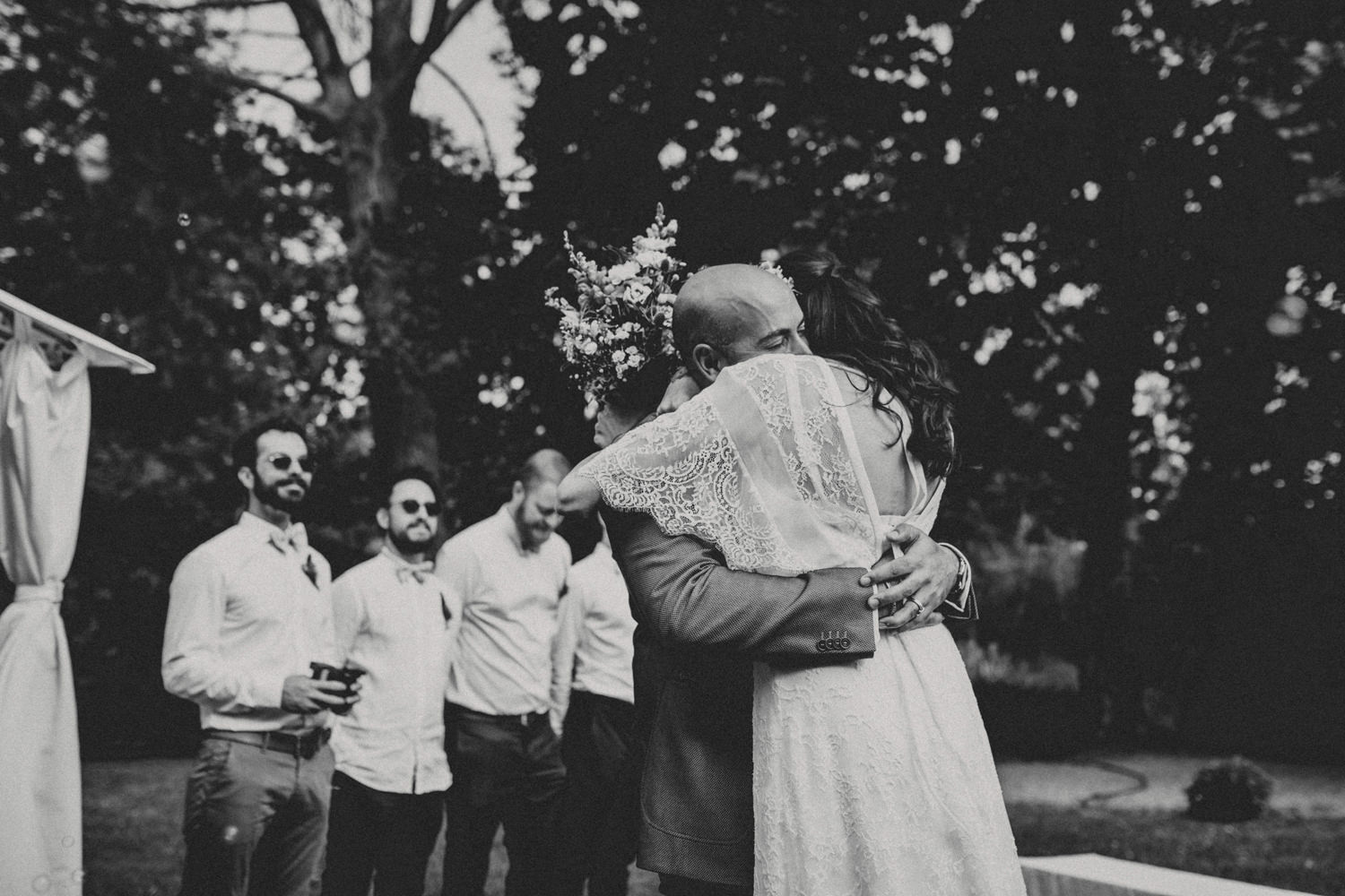 bride and groom hugging before an outdoor ceremony in portugal