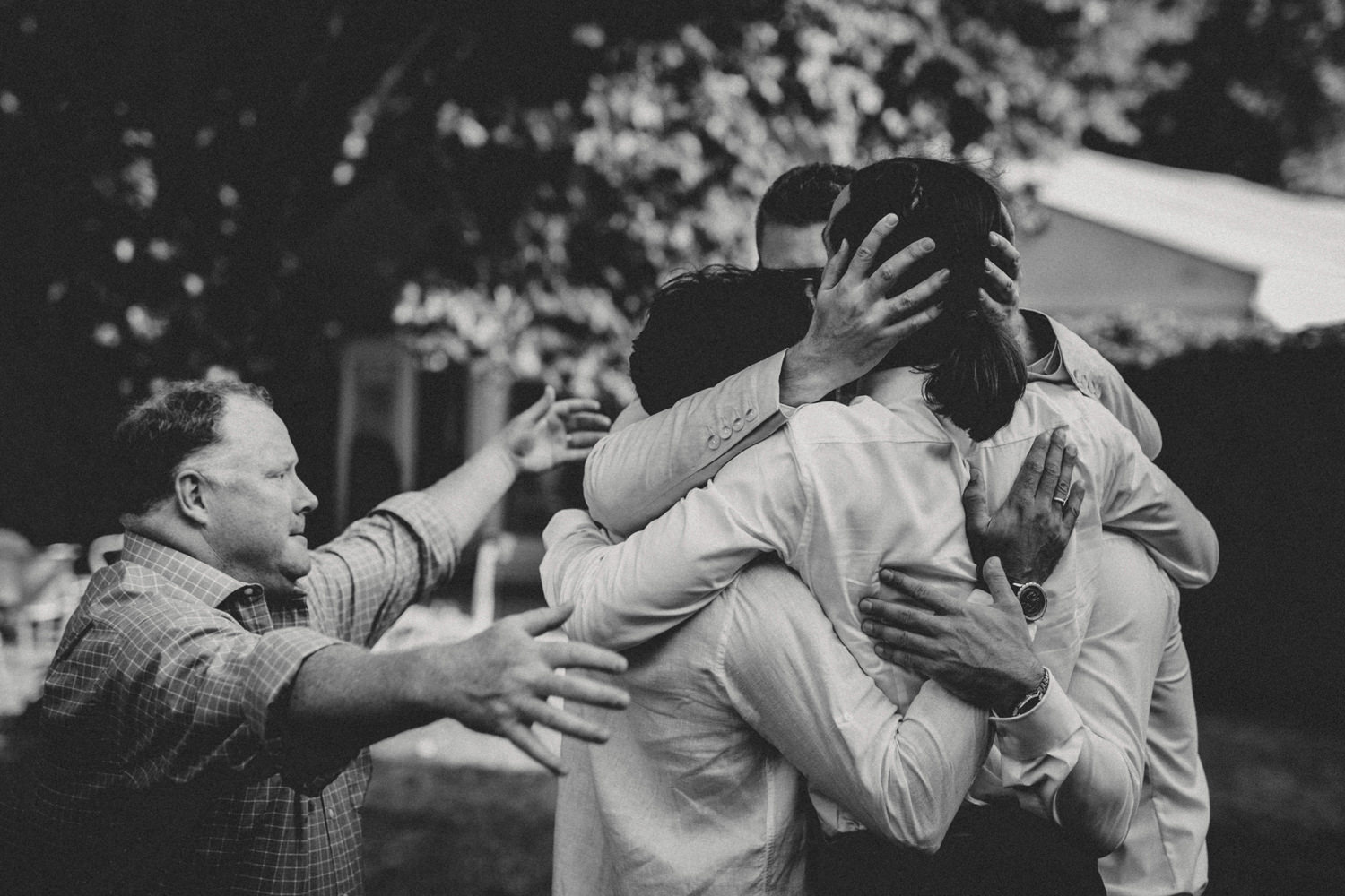 guest hugging after a boho wedding ceremony in portugal