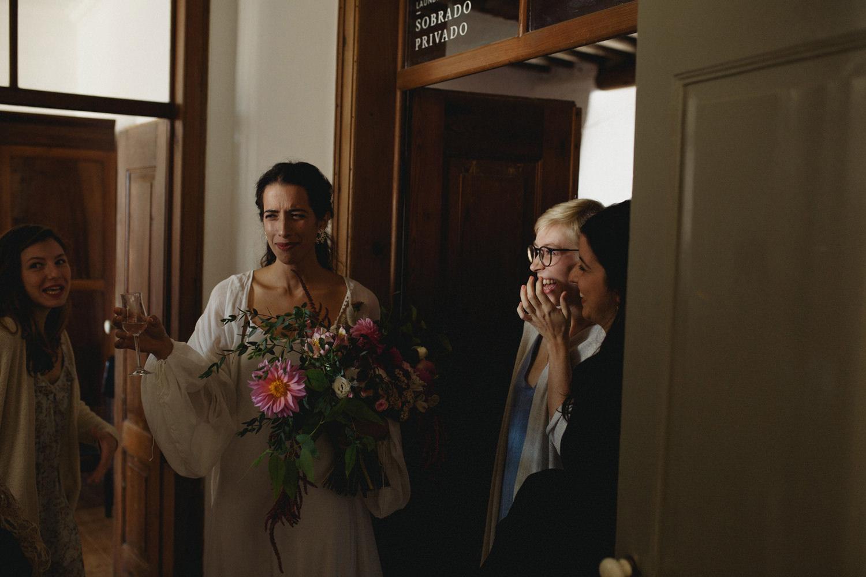 bride drink a shot before wedding ceremony in algarve