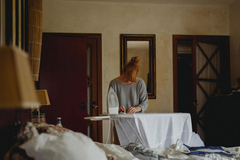 bride irons her dress before wedding