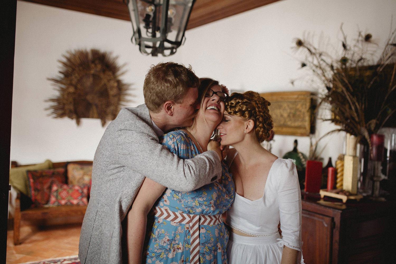 bride and groom hugs grooms mother in portugal wedding