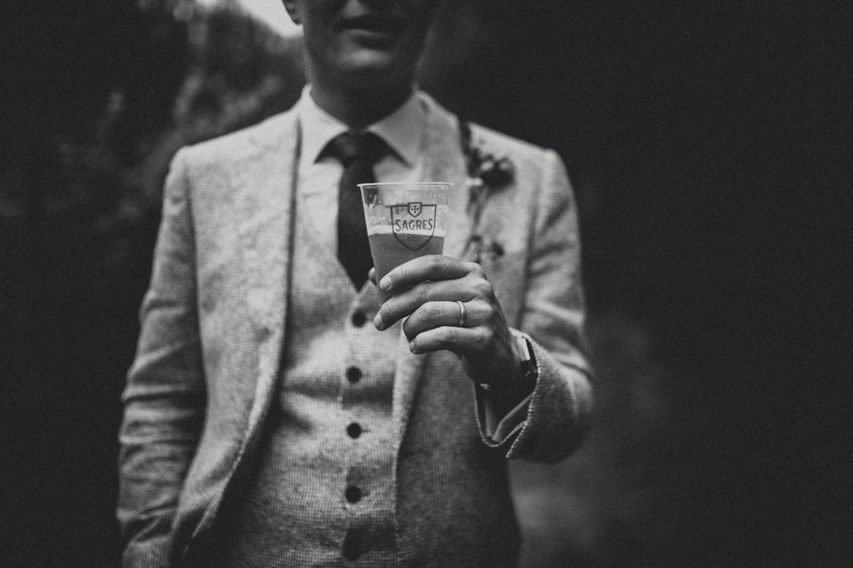 groom holding beer in portugal wedding